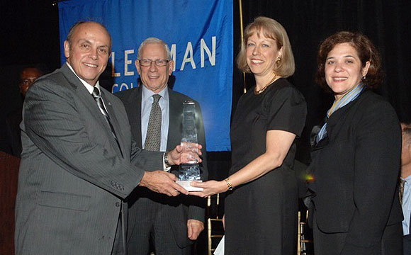 Lehman President Ricardo R. Fernández (left) presents the Corporate Leadership Award to JP Morgan Chase Senior Vice President and District Manager Eileen Conroy at the College's annual Leadership Dinner, held on October 27 at the New York Botanical Garden. With them are David Levey, chair of the Herbert H. Lehman Foundation, which sponsored the dinner, and Elsie Leon-Cruz, JP Morgan Chase senior vice president and market manager. President Fernández and Borough President Rubén Díaz, Jr. were also recognized at the event, which raised more than $400,000 in cash and pledges for student scholarships, fellowships, an endowment and College needs.