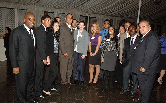 Borough President Rubén Díaz, Jr. (center) with Lehman and CUNY officials and some of the students benefitting from the scholarship funds raised at the College's annual Leadership Dinner. The event was held on October 27 at the New York Botanical Garden and raised more than $400,000 in cash and pledges for scholarships, fellowships, an endowment and College needs. Receiving awards were JP Morgan Chase Senior Vice President and District Manager Eileen Conroy, Borough President Díaz (who is a Lehman alumnus), and Lehman President Ricardo R. Fernández.