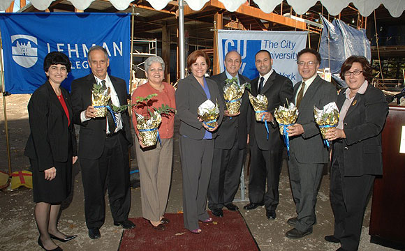 City Council members, along with Lehman and CUNY officials, celebrated the topping-off of Lehman College's science building. A City Council allocation is providing funding for the building's new rooftop greenhouse. The plants in the photo were grown in Lehman's current teaching and research greenhouse.