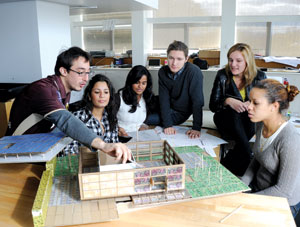 Discussing pre-schematic model of their design are, from left, architecture students John Vlahakis, Yinery Baez, Relbin Thomas, Rostyslav Pechenyy, Iskra Petrova and Yelisa Grullon.