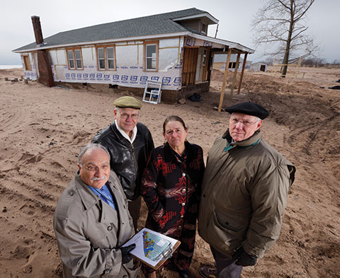 At New Dorp Beach, Staten Island: left to ritght: Dr. Alan Benimoff, Interim CSI President Dr. William J. Fritz, Dr. Lacey Sloan, and Dr. Michael Kress.