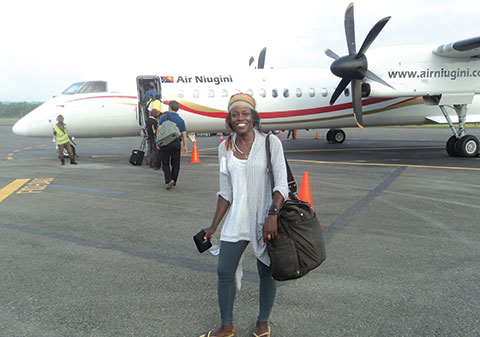 Mandë Holford boarding plane to Madang, Papua New Guinea, for the expedition. Below, assortment of cone snails collected.