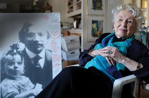 Bel Kaufman at home in Manhattan. In the backgound, a picture of her and her grandfather Sholem Aleichem, whose stories inspired the musical 'Fiddler on the Roof.'