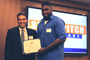 Rolando Franco, Executive IT Architect with IBM (left) congratulates Dwight Peters, a Baruch undergraduate Entrepreneurship major, who won first place in the SmartPitch Challenge, hosted by Baruch College and IBM.