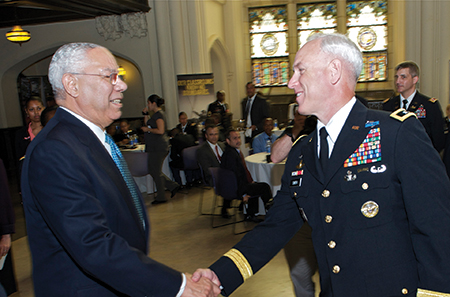 ROTC Returns to CUNY: Gen. Colin Powell (Ret.) left, shakes hands with Maj. Gen. Jefforey Smith, commander of the U.S. Army Cadet Command, at a special City College ceremony May 21, re-establishing the Army Reserve Officers Training Corps program at CUNY.