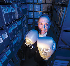 HISTORY LESSON BEST OF BOXING: Professor emeritus Anthony Cucchiara stands in the middle of the largest collection of boxing memorabilia in the world, now in an archive at Brooklyn College. The collection was dedicated to the college by Hank Kaplan on his death in 2007, with boxing material from as far back as 1814.