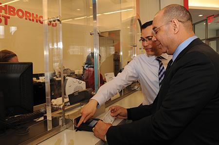 Ruben Felix, right, with financial adviser Adalberto Jaimes at the Neighborhood Trust Federal Credit Union