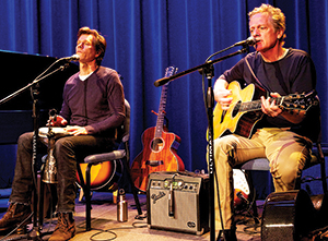 The Bacon Brothers, Kevin and Michael, perform at Lehman College.