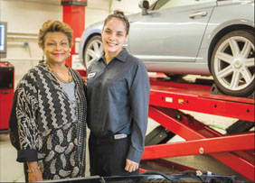 BCC President Carole M. Berotte Joseph with Grace Claudio, a 2010 graduate of the college's auto tech program, now working for BMW of Manhattan.
