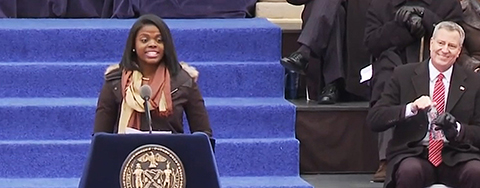 Medgar Evers senior Lissette Ortiz introduces former President Bill Clinton, who presided over the swearing-in ceremony of Mayor Bill de Blasio.