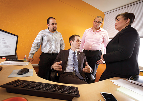 Loic Audusseau, seated, chief technology officer at Bronx Community College, and, left to right, teammates Jonathan Lacay, Jonathan Guerra and Luisa Martich.