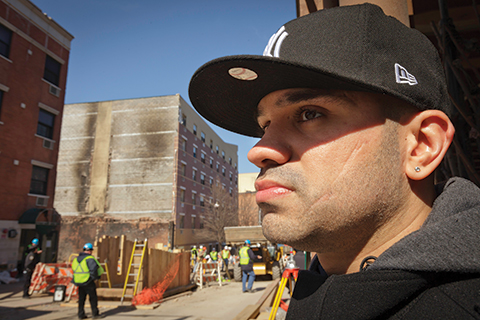 Ruben Borrero, a BMCC student, at the site of the explosion that destroyed the buildings where three generations of his family had lived.