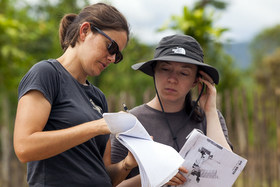 Third-year graduate architecture students Michele Flournoy, left, and Tiffany Kimmel on site in January reviewing plans for the Yantaló Hospital Volunteer House in northern Peru.