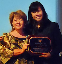 Professor Janet Liou-Mark (right) being presented her award by Elena Goloubeva (left).