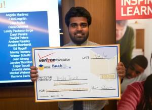 AdityaKumarakrishnan, a senior at Queens College and creator of Tesla Truck, holds the winning check for $10,000.