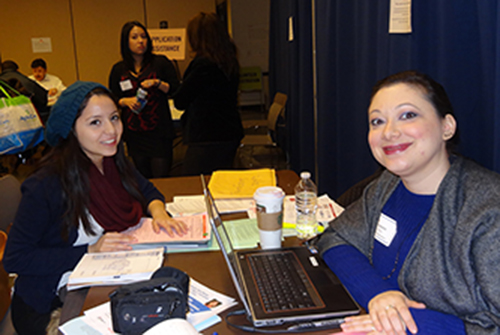 Diana Arias, a Baruch College junior, receives assistance with her application.