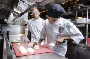 Chef Ian Vest and Tatianna Taylor at her garde-manger station at DBGB Kitchen & Bar. Credit: A. Vargas