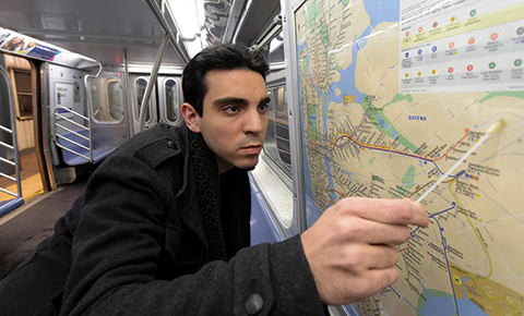 Ebrahim Afshinnekoo collecting a swab of organisms from a subway map.