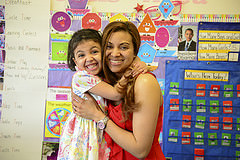 "Class of 2015 Valedictorian, Kirssy Martinez, with her daughter Haley. Kirssy is a ""The DREAM.US""Scholarship recipient; the first such scholar within The City University of New York to earn the distinguished honor of being named Valedictorian, representing the 2015 graduating class. TheDREAM.US provides college scholarships to highly motivated DREAMers who, without financial aid, cannot afford a college education that will enable them to participate in the American workforce."