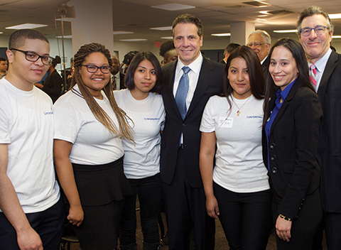 CUNY students and Call-In volunteers Juan Parra, Kasandra Dorce, Guadalupe Muller, Monica Sibri and Jennifer Fernandez with Gov. Cuomo and Citizenship NOW! Director Allan Wernick