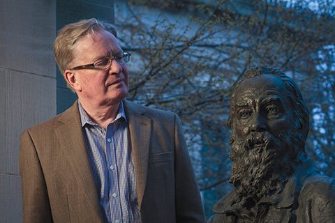 Gary Schmidgall, with bronze bust of poet Walt Whitman at Bronx Community College's Hall of Fame of Great Americans
