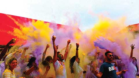 Queens College students raise funds for quake victims while celebrating the Hindu Festival of Colors,
