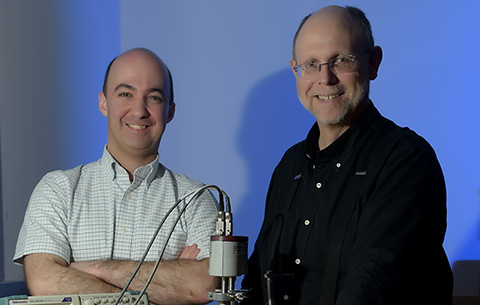 L-R: Dr. Kevin Lynch and Dr. James Popp, high energy physicists and professors in the Physics Department at CUNY's York College fix high vacuum equipment in the experimental high energy physics lab. © Audrey C. Tiernan