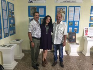 Professor Teresita Levy with education officials in Cuba.