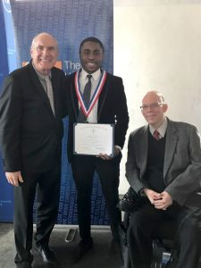 photo of KCC student Olalekan Shonowo with President Herzek and Christopher Rosa, CUNY's Interim Vice Chancellor for Student Affairs.