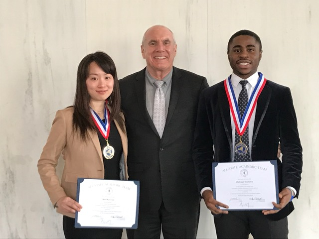Photo of KCC student Mei Wai Tsui (left) and Olalekan Shonowo (right) with Kingsborough President Farley Herzek at today's ceremony in Albany honoring student members of Phi Theta Kappa's All-State Community College Academic Team.