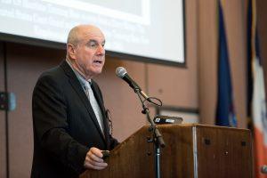 Photo of KCC President Farley Herzek addressing attendees at Coast Guard meeting