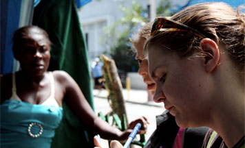 3L Thyra Smith (right) interviewing a camp resident in Champ de Mars on 10/10/2010