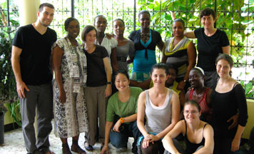 With KOFAVIV members and displacement camp outreach workers, Prof. Lisa Davis (standing, right), IWHR Clinic Fellow Bradley Parker (standing, left) (kneeling, l-r) - 3L April Marcus, 3L Brenda Hasslinger, 3L Thyra Smith, 2010 IWHR alum Nora Smiley. Photo courtesy of Bradley Parker.