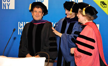 CUNY School of Law Dean Michelle Anderson, center, and Executive Vice Chancellor and University Provost Alexandra Logue congratulate Johnny Clegg at his award ceremony.