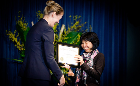 Dean Michelle J. Anderson presents Susan Chang, Professional Skills Center, with an award for 25 years of service to the Law School.