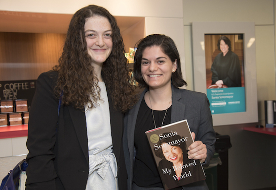 Maria Amor ('17), at right, shows off her signed copy of Justice Sotomayor's book along with classmate Alexa Rogers ('18).