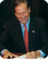 Pataki signing a document