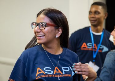 Smiling student wearing an ASAP T-Shirt