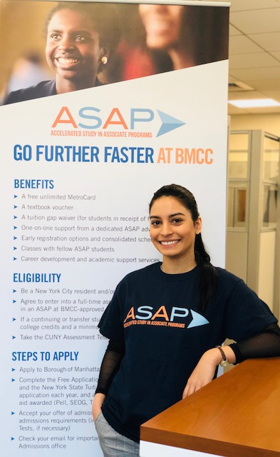 CUNY ASAP Student standing in front of ASAP BMCC Sign