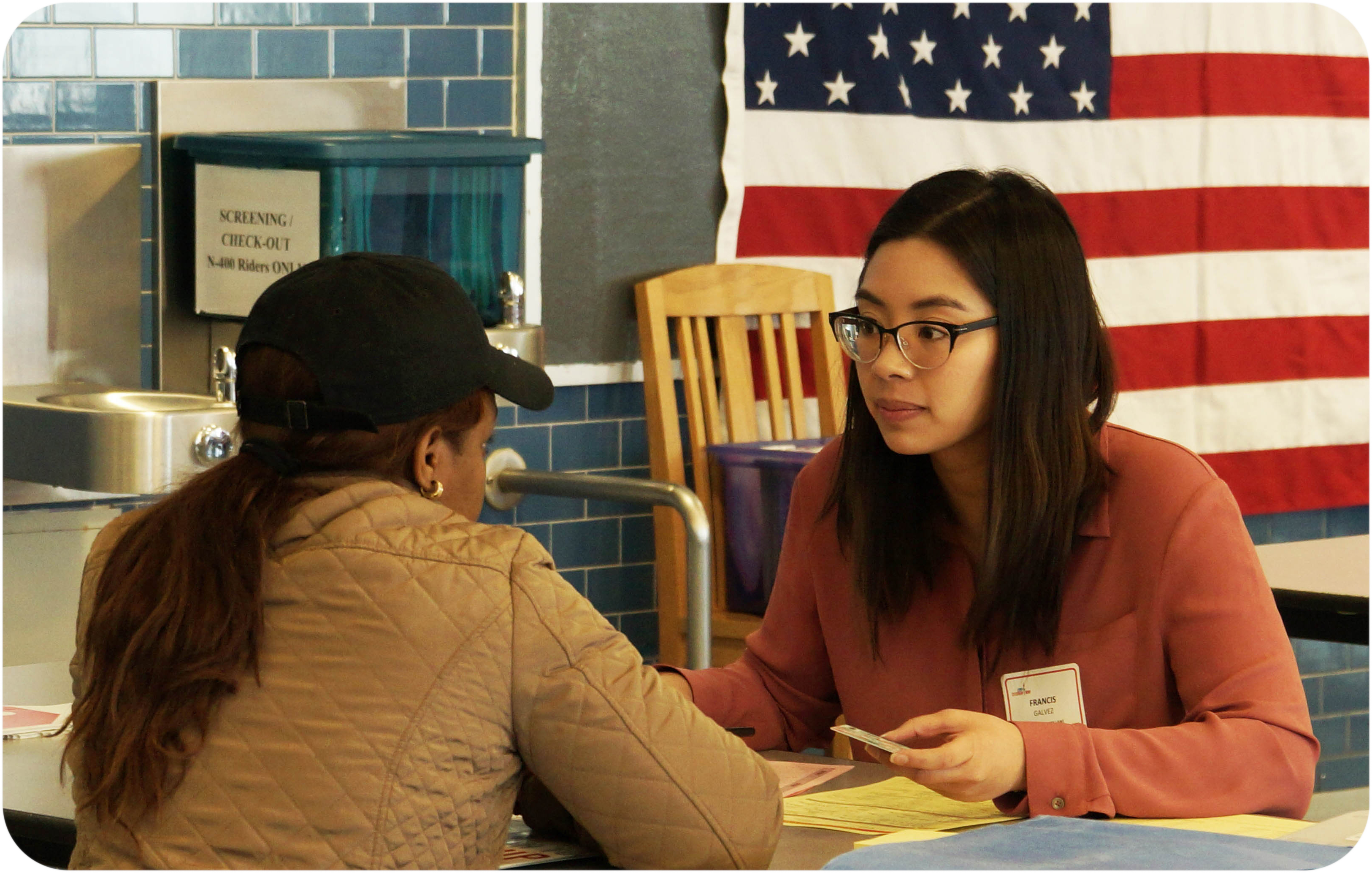 Volunteer assists participant at one of our events