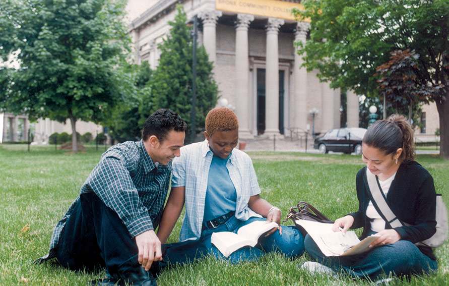 Three students studying on BCC lawn