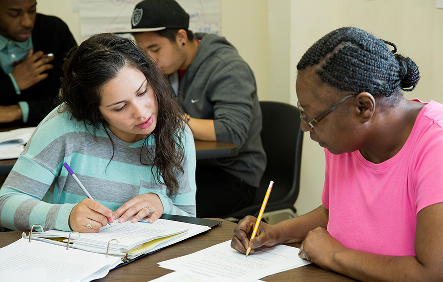 Two CUNY Start students working together in a classroom