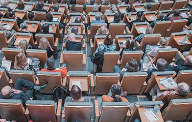 Faculty in auditorium