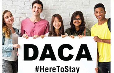 students hold sign DACA #HereToStay
