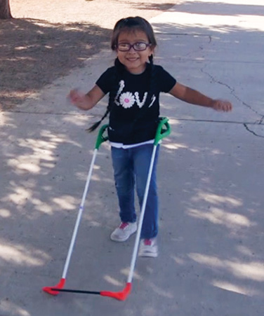 sight impaired child using a Toddler Cane