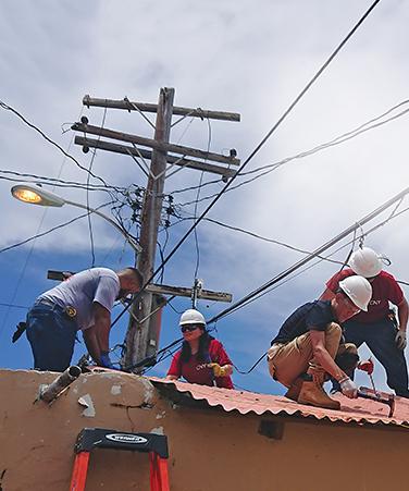 CUNY Service Corps volunteers in La Playita, Santurce, Puerto Rico, part of the Hurricane Maria relief effort