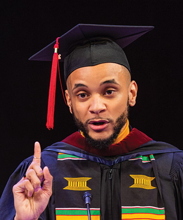 Student Speaker K. Domenic McKenzie at the Craig Newmark CUNY Graduate School of Journalism 2018 commencement, held at the [New York] Times Center