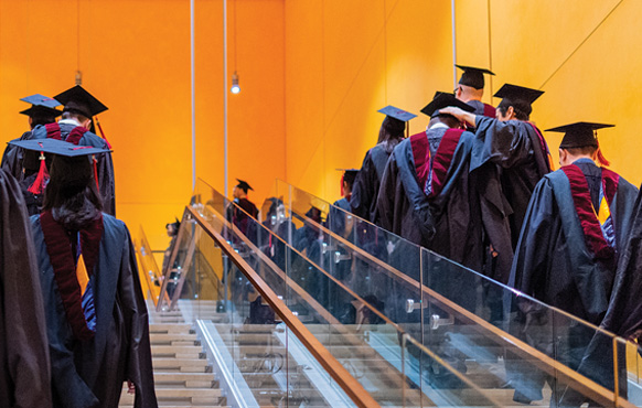 CUNY Craig Newmark Graduate School of Journalism students in procession up stairs during during the 2018 commencement