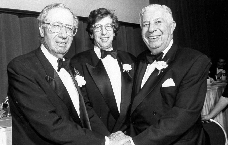 New York City builders, Lewis Rudin, William C. Rudin, and Jack Rudin at a Real Estate Board of New York banquet, 1995. Jack Rudin graduated from The City College of New York.