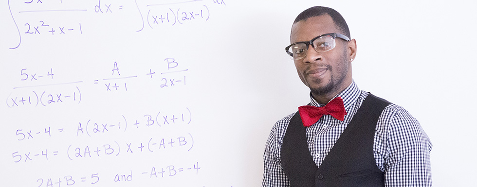math student in  front of white board